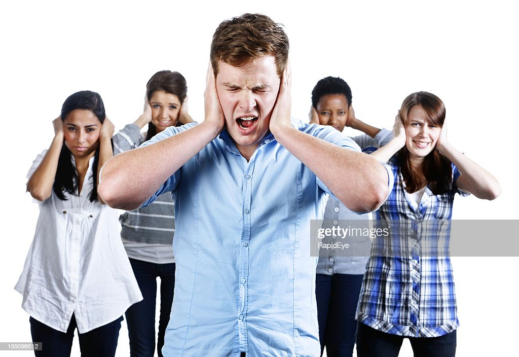 Five people with hands over their ears grimace at noise : Stock Photo