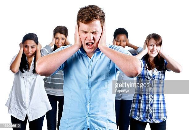 Five people with hands over their ears grimace at noise