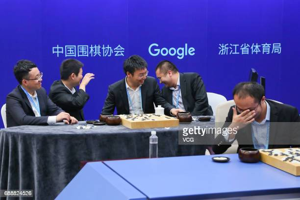 Five players Shi Yue Mi Yuting Tang Weixing Chen Yaoye and Zhou Ruiyang form a team to compete against AlphaGo during the Future of Go Summit at...