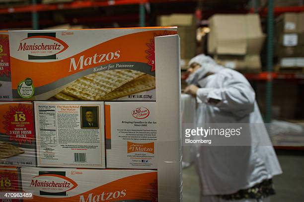 Five pound cartons of Passover matzo sit stacked on a palette at the Manischewitz Co factory in Newark New Jersey US on Thursday Feb 20 2014...