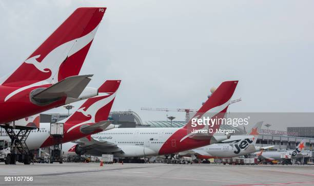 Five Qantas and Jetstar aircraft lined up at Changi Airport on March 12 2018 in Singapore Qantas has signed a new partnership with the Singapore...