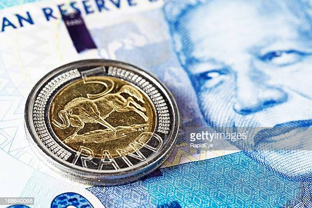 five rand coin rests on new mandela south african banknote - south african currency stock photos and pictures