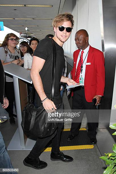 Five Seconds of Summer is seen at LAX on December 08 2015 in Los Angeles California