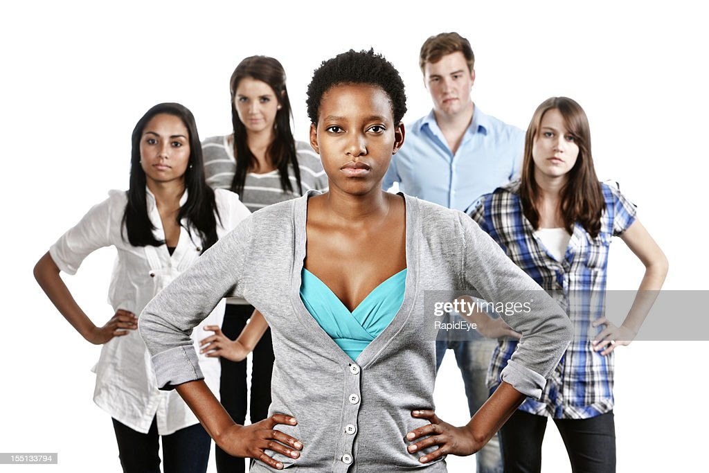 Five serious young people look accusing, hands on hips : Stock Photo