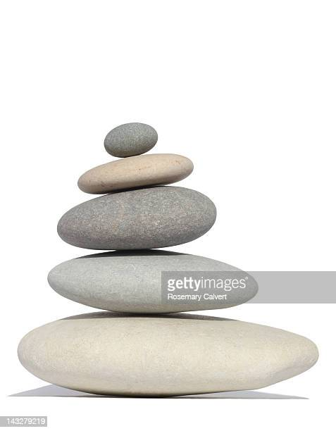 Five smooth pebbles stacked in order of size