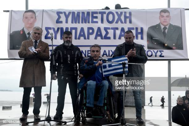 Five speak on stage as they take part in a rally organized by various groups through social media next to the statue of Alexander the Great in...