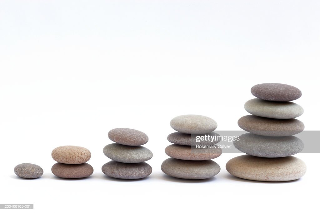 Five stacks of round, smooth pebbles : Stock Photo
