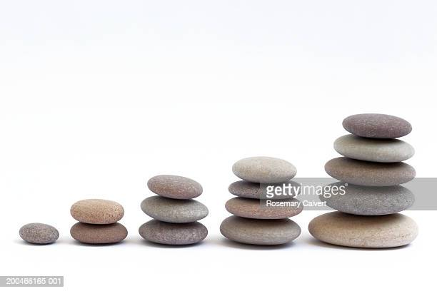 Five stacks of round, smooth pebbles