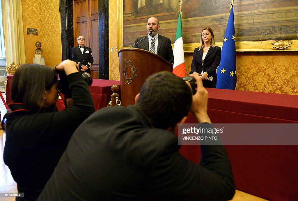 Five Star Mouvement party's Vito Crimi and Roberta Lombardi (R) answer journalists on April 25, 2013 in Rome, after a meeting with Italian moderate leftist Enrico Letta on April 25, 2013 in Rome, as Letta began complex talks on forming a new coalition government aimed at tackling what the prime minister-designate called a social 'emergency'. The 46-year-old Letta, who would be one of Europe's youngest leaders if he succeeds, has said he wants a government that is more in tune with the needs of ordinary Italians and that can steer away from harsh austerity measures.s