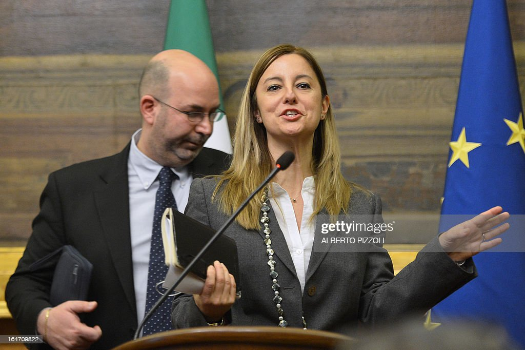 Five Star Movement leader in the Senate Vito Crimi (L) and 5-Star leader in the lower house of parliament Roberta Lombardi give a press conference after their meeting with leftist leader Pier Luigi Bersani on March 27, 2013 in Rome. Bersani was given the official go-ahead on March 23, 2013 to try and form a government after February elections that left the country in political gridlock.