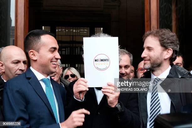 Five Star Movement leader Luigi Di Maio jokes with movement's founders Beppe Grillo and Davide Casaleggio outside the Interior Ministry on January 19...