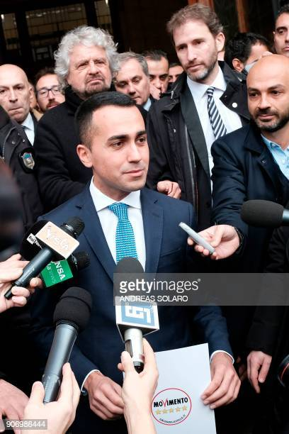Five Star Movement leader Luigi Di Maio speaks to journalists flanked by movement's founders Beppe Grillo and Davide Casaleggio outside the Interior...