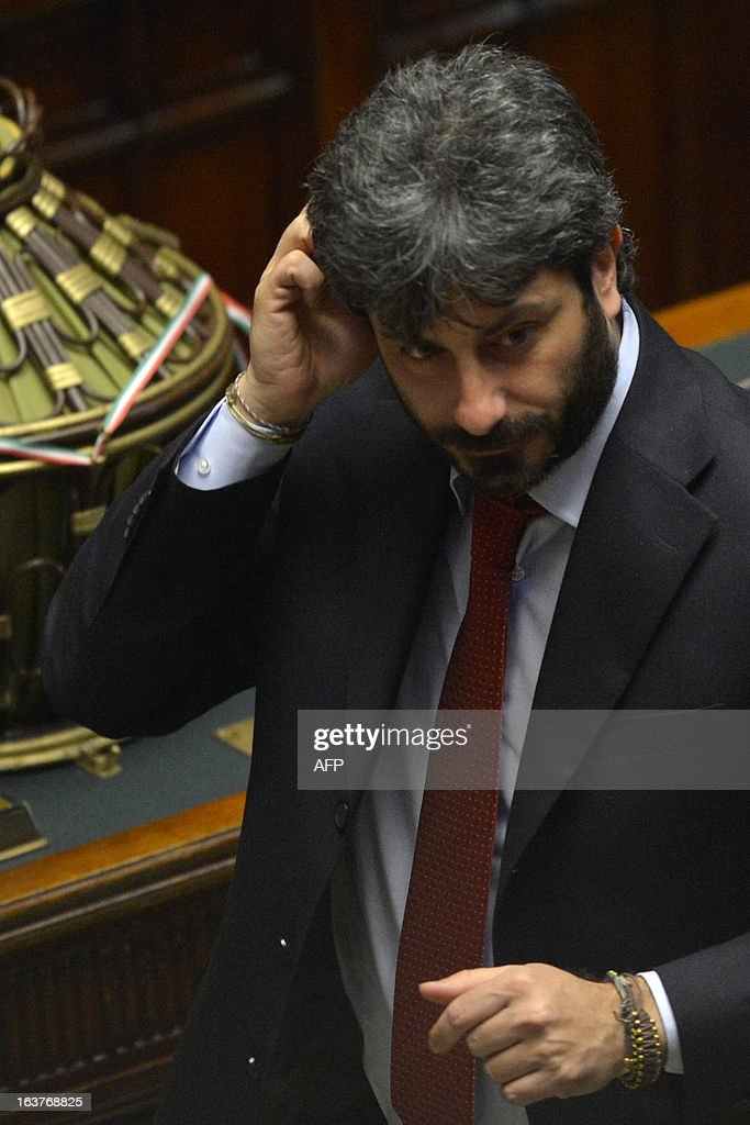 Five Star Movement newly elected member of parliament Roberto Fico casts his ballot during the first session of Italian lower-house on March 15, 2013 in Rome. General election in Italy took place on February 26 but as a majority in both chambers of parliament is required to form a government, Italy is left in a state of limbo with a hung parliament that is unprecedented in its post-war history.