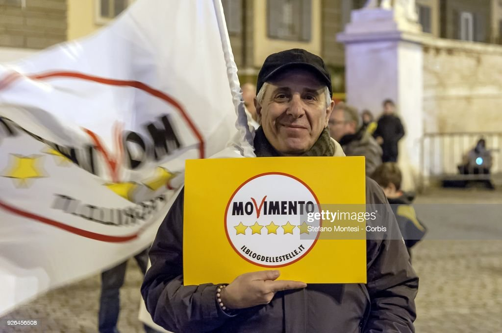 Five Star Movement (M5S) supporters gather as they wait for party leader Luigi Di Maio at the last general election campaign meeting in Piazza del Popolo on March 2, 2018 in Rome, Italy. The Italian general election is March 4.