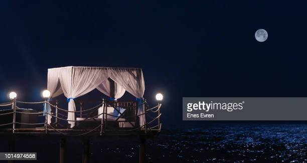 five stars luxury hotel's pavilion by the sea at night - phosphorescence stock pictures, royalty-free photos & images