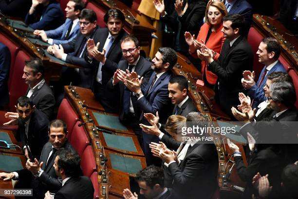 Five Stars Mouvement leader Luigi Di Maio and M5S deputies applaud after Five Stars Mouvement deputy Roberto Fico was elected Chamber President...