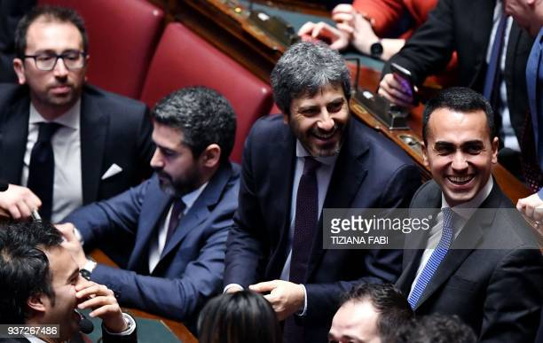 Five Stars Mouvement leader Luigi Di Maio and M5S deputy Roberto Fico laugh during the second session following the March 4 vote at the Chamber of...