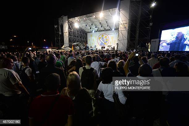 Five Stars movement's leader and former comedian Beppe Grillo delivers a speech to launch the Italia 5 Stelle three day rally on October 10 2014 at...