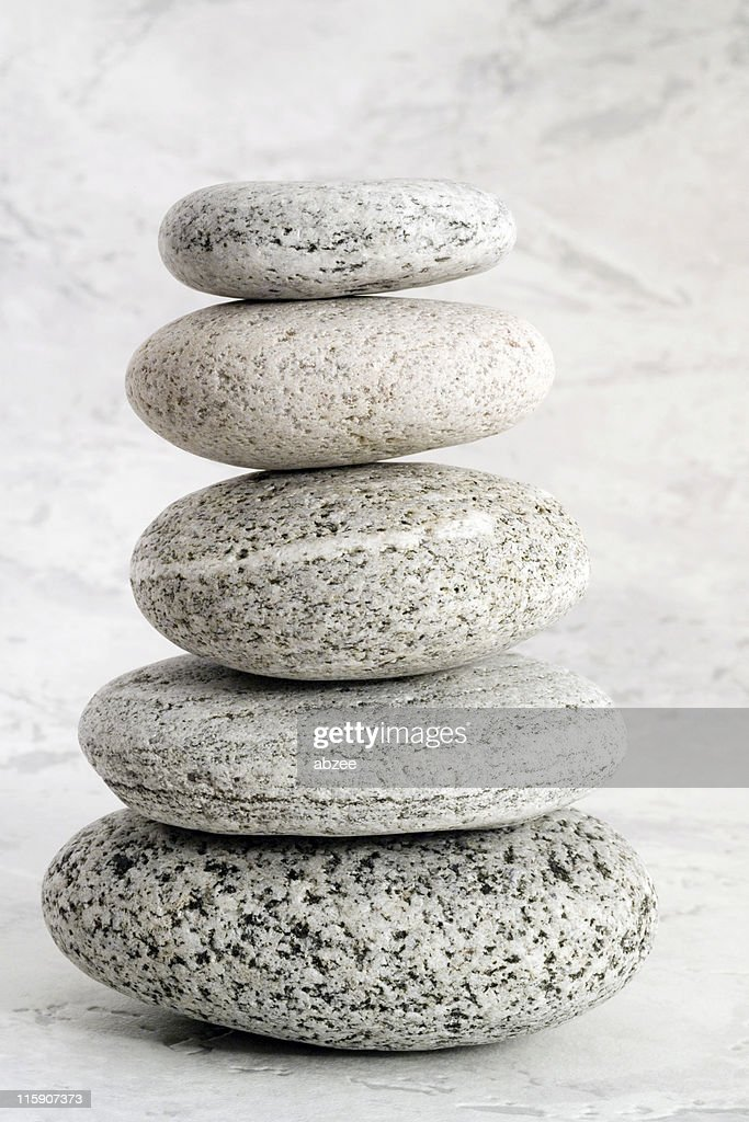 Five stones against textured backdrop : Stock Photo
