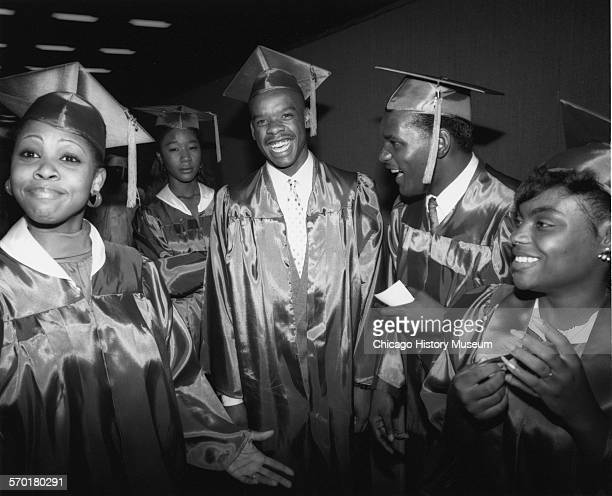 Five students in cap and gown gathered for South Shore Community Academy Commencement exercises for the class of 1988 held at the Illinois Institute...