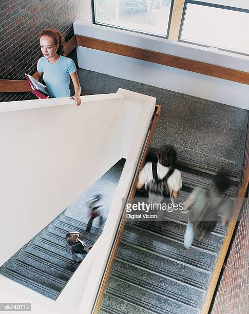 Five Students Walking Up a Stairwell