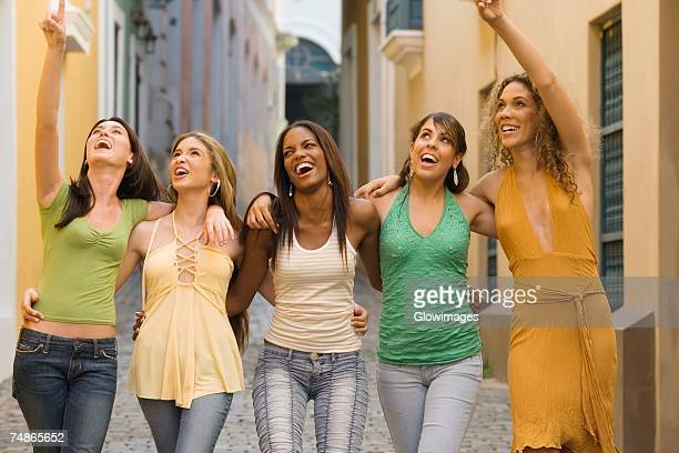 Five teenage girls with their arms around each other