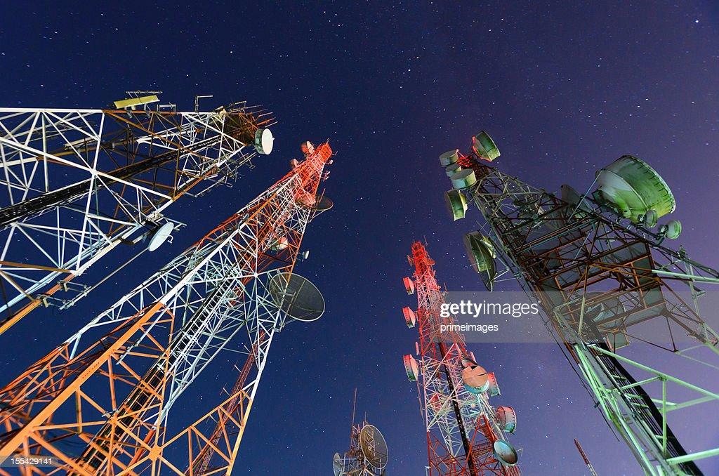 Five telecommunication towers under a night sky  : Stock Photo