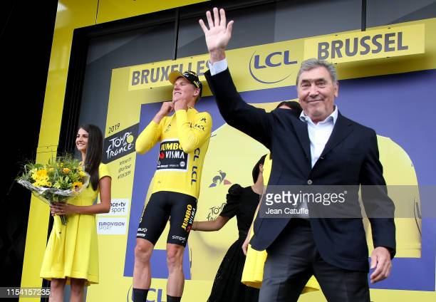 Five time Tour de France winner Eddy Merckx gives the first leader's yellow jersey to Mike Teunissen of the Netherlands and Team JumboVisma during...