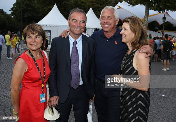 Five time winner of the Tour de France Bernard Hinault and his wife Martin Hinault pose with three time winner of the Tour Greg LeMond of USA and his...