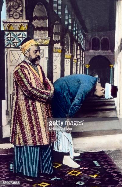 Five times a day the Mohammedans of the muezzin the muezzin from a minaret towers high the call to prayer Islam requires its followers except the...