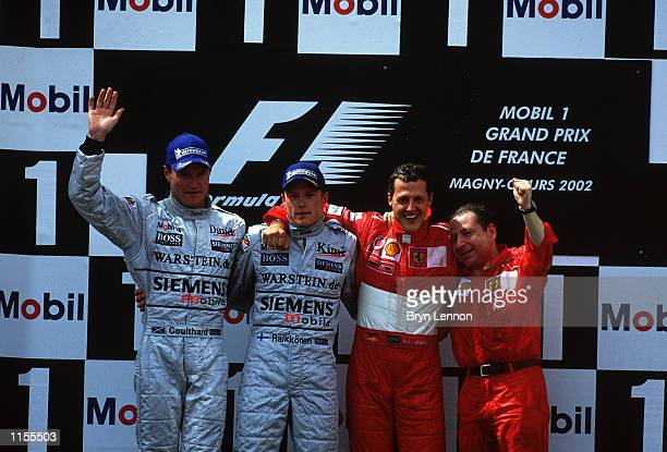 Five times Formula One Champion Ferrari driver Michael Schmacher of Germany celebrates with Ferrari's Team Principal Jean Todt with McClaren Drivers...