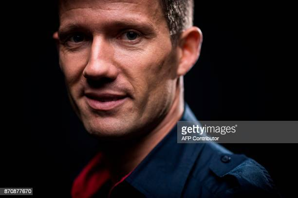 Five times World Rally Champion French driver Sebastien Ogier poses during a photo session on November 6 2017 in Paris / AFP PHOTO / Lionel...
