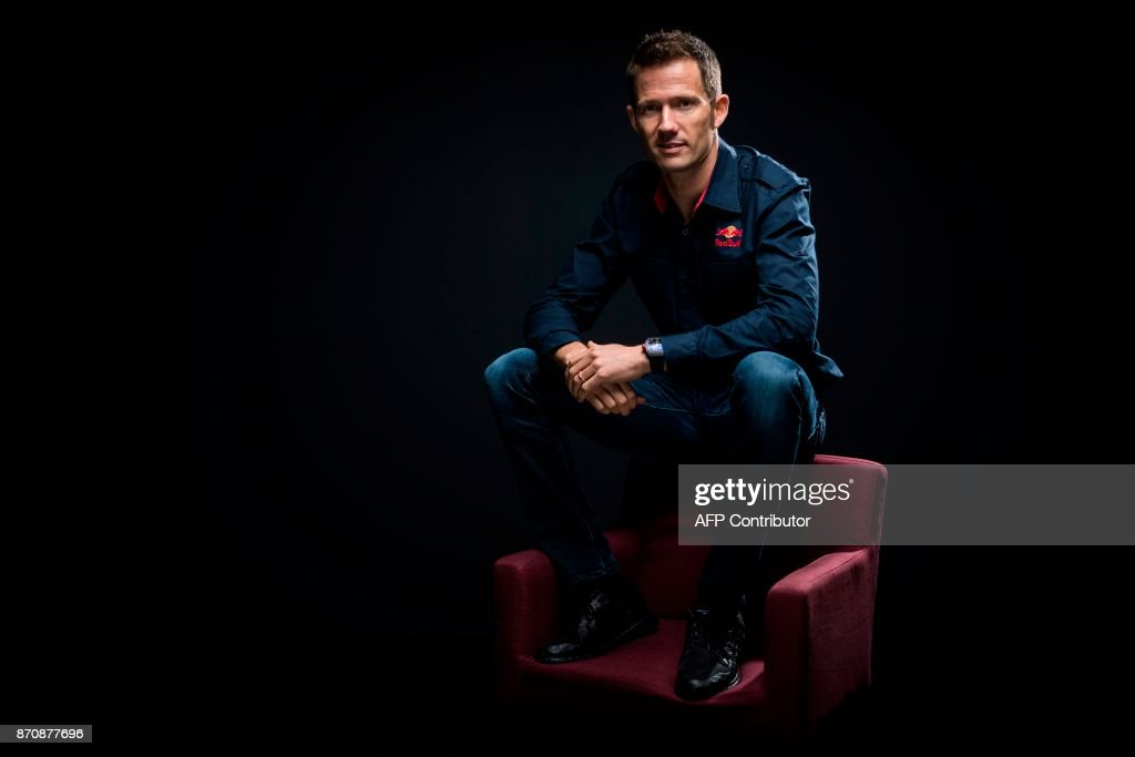 Five times World Rally Champion, French driver Sebastien Ogier, poses during a photo session on November 6, 2017 in Paris. / AFP PHOTO / Lionel BONAVENTURE
