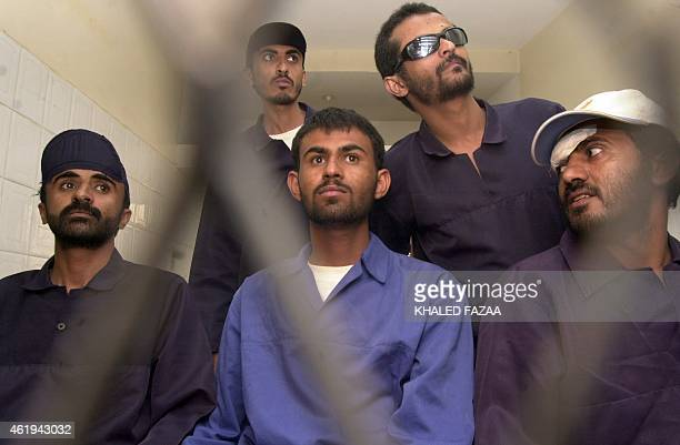 Five unidentified Yemeni suspects listen to the judge from behind court bars at the final hearing session of their trail in Sanaa 29 March 2006 Four...
