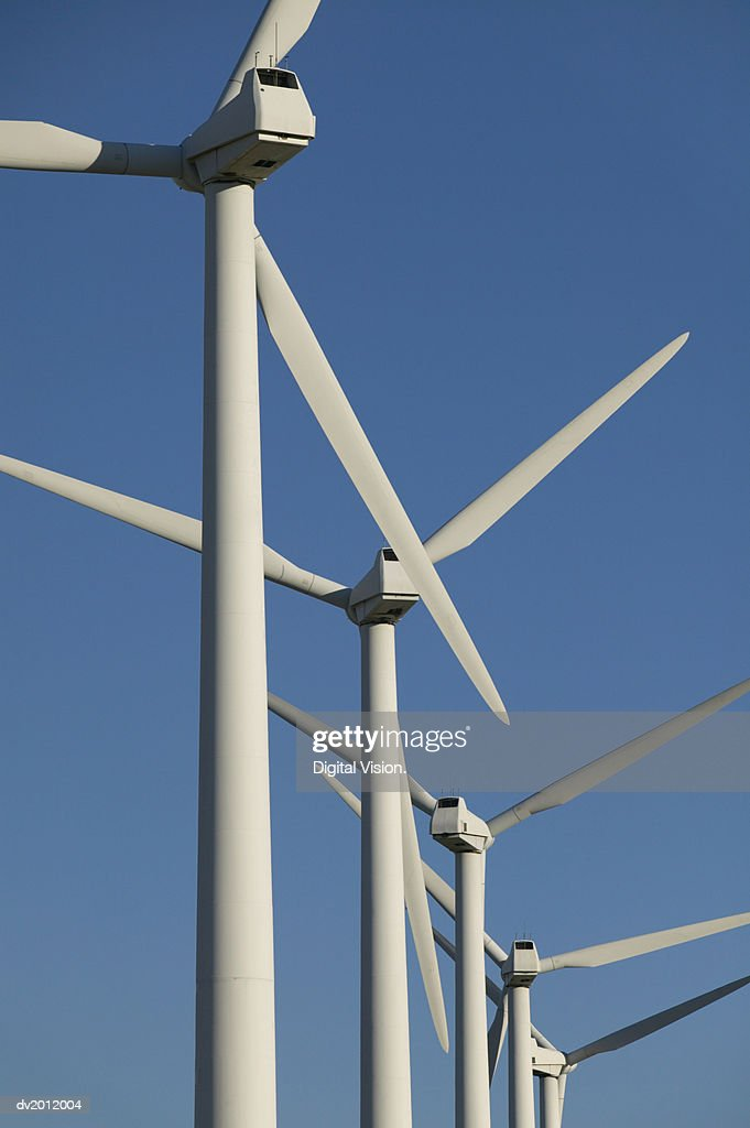 Five Wind Turbines in a Row Against a Blue Sky : Stock Photo