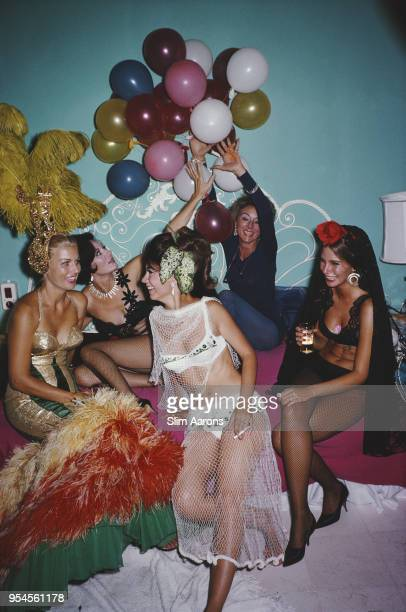 Five women in costumes partying at Emi Fors Acapulco Mexico 1966