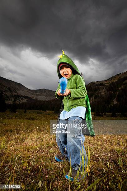 Five year old boy wearing a dragon cape