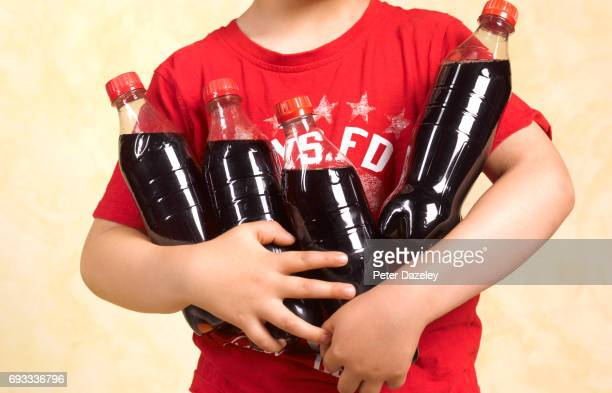 five year old boy with cola close up - unhealthy living stock pictures, royalty-free photos & images