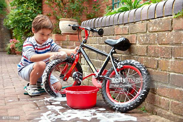 Five year old cleaning his bike