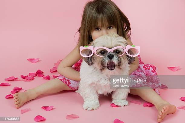 Five year old girl with her dog (Shih Tzu)