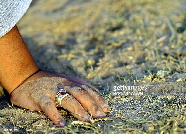 Five yearold Amir Hussein rests at a park transformed into a football playground in the Baghdad 19 September 2004 On a dusty pitch in the heart of...