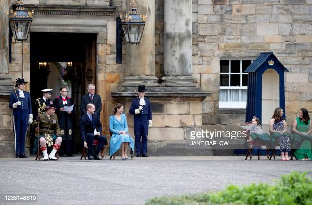 Five year-old cancer patient Mila Sneddon , who features in an image from the Hold Still photography project, waves to Britain's Prince William, Duke...
