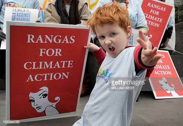 Five yearold Findlay Gledhill holds a banner as a group of redheads hits the streets of Melbourne protesting their view that there has been a lack of...