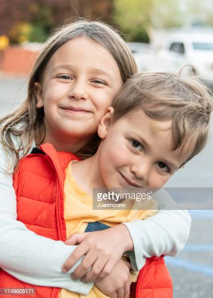 five years old child girl posing with her three years old brother - 4 5 years stock pictures, royalty-free photos & images