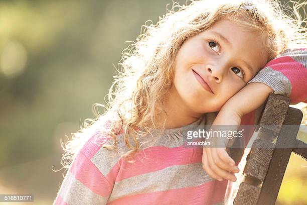 five years old girl day dreaming portrait - 4 5 years stock pictures, royalty-free photos & images