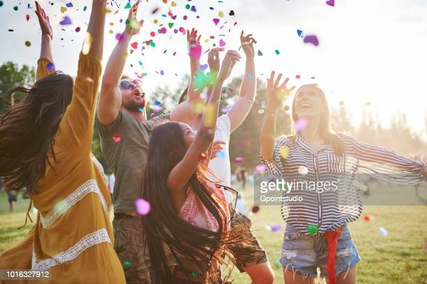 five young adult friends throwing confetti mid air at holi festival - entertainment event stock pictures, royalty-free photos & images