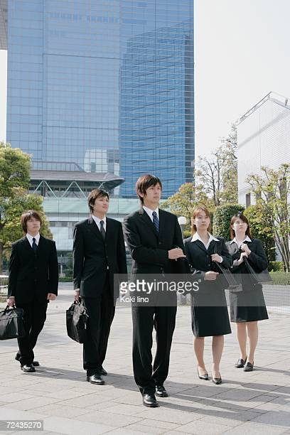 Five young businessperson standing