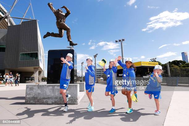 Five young fans imitate Dennis Lillee's bowling action in front of the Dennis Lillee statue located outside the MCG during a Southern Stars training...