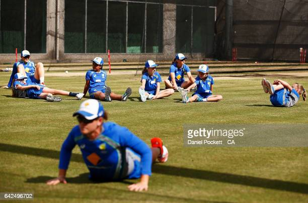 Five young fans participate in warmups with the players during a Southern Stars training session at Melbourne Cricket Ground on February 18 2017 in...