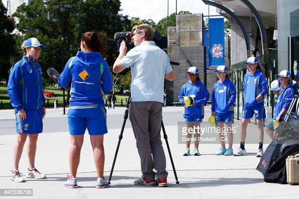 Five young fans watch on as Alex Blackwell talks to the media during a Southern Stars training session at Melbourne Cricket Ground on February 18...